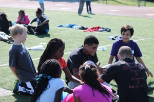 High school leaders led discussions in the middle school as well as on the football field