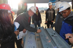 STEM students put their mark on the final beams.