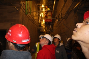STEM students view internal structure of job site.