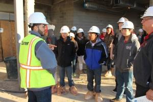 STEM students start tour of Viking Village job site.