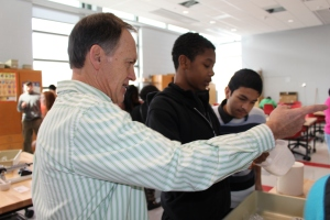 Tom Huetter assists STEM students as they create toothpaste.